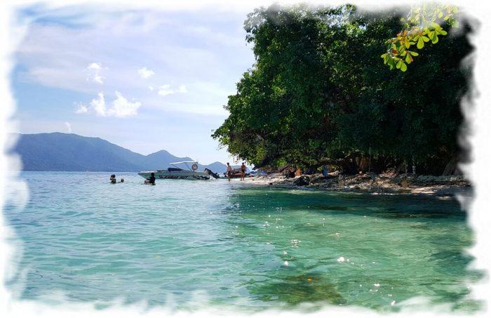 View of the small beach of Ko Yuak (far away - Koh Chang)
