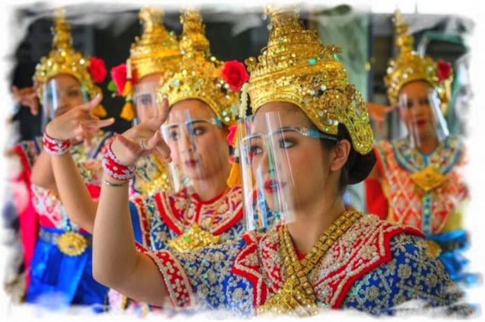 Thai dancers in national dress and face shields